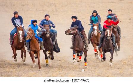Shymkent, Kazakhstan, November 5, 2018. Nomad riders train on horseback in the steppes of Kazakhstan. Kazakh traditions. Folk entertainment. Kazakh national game Kokpar.