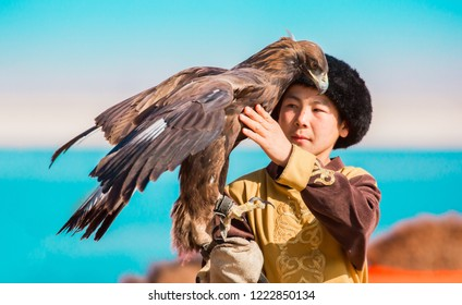 Shymkent, Kazakhstan - October 26, 2018: Kazakh hunter (Berkutchi) with golden eagles on hand. Hunting with the help of an eagle on a hare. Hunter on a horse with a bird in his arms. Kazakhstan touris