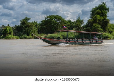 Si Phan Don, Laos - December 8, 2018: Travelling by boat along Mekong river in south Laos is a famous tourist attraction.