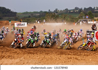 SI RACHA, THAILAND - MAR. 10 : Group of motocross riders at first curve during MX1/2 super final race of The FIM Motocross World Championship Grandprix of Thailand, on March 10, 2013. Thailand.