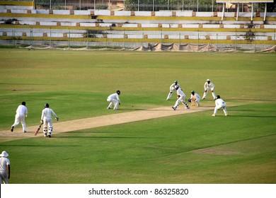 SIALKOT, PAKISTAN - OCTOBER 08: Danish Kaneria bowling during Quaid-e-Azam Trophy Cricket Match Played Between Sialkot and HBL Teams at Jinnah Cricket Stadium. October 08, 2011 in Sialkot, Pakistan
