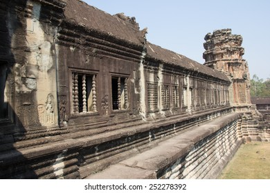 SIAM REAP, CAMBODIA - February 7,2015 -The main temple of Angkor Wat, seen from the causeway on the western approach, draws thousands of visitors from all over the world.