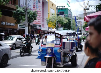 Siam square , Bangkok , Thailand - 29 Aug 2019 : TUK TUK taxi, Thailand's most famous transportation of tourist, parking on the traffic street near Siam Paragon area, one of most popular tourists.