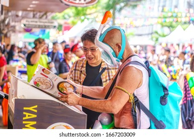 Siam Square, Bangkok, Thailand - APR 13, 2019: short action of people joins celebrations of the Thai New Year or Songkran in Siam Square.