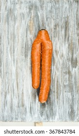 Siamese carrots on a wooden board