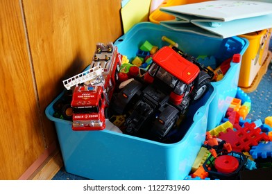 Sianozety, Poland - July 19, 2015: Mix of toys including vehicles in a blue box in a toy room