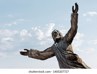 SIAULIAI, LITHUANIA - JUL 22, 2018: Wooden statue of Jesus Christ at the Hill of Crosses. Hill of Crosses is a unique monument of history and religious folk art