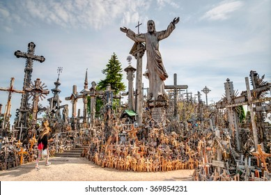 SIAULIAI, LITHUANIA - JULY 18: Pilgrims visiting Hill of crosses (kryziu kalnas) a famous religious landmark in Lithuania on July 18, 2015