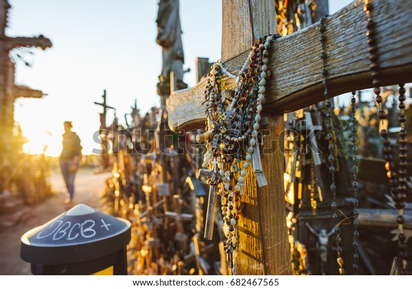 SIAULIAI, LITHUANIA - JULY 22, 2017: Hill of crosses (Kryziu kalnas), pilgrimage site in northern Lithuania, summer sunset time