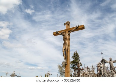 SIAULIAI, LITHUANIA - MAY 1, 2015 : View of hill of crosses with over four hundred thousand crosses and crucifix, which is thought  tradition of putting a cross traces to 1800s.