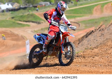 SIAULIAI,LITHUANIA-MAY 13:Unidentified rider in action in Lithuanian Open Motocross Championship 2017  first roundon on May 13,2017 in Siauliai, Lithuania.