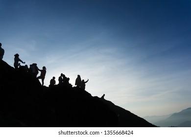 Sibayak, Indonesia - Mey 2, 2016: Some teenagers are taking selfie photos on Mount Sibayak.