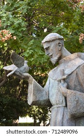 Sibenik, Croatia - August 18, 2017: Public statue of Saint Francis of Assisi holding a dove and a cross, in the park next to the church of Our Lady out of town