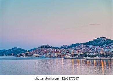 SIBENIK, CROATIA - August 20, 2018 Coastal panoramic view of the old city center at sunset.