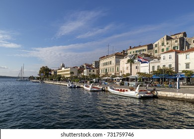 Sibenik in Croatia, old part of town with colorful stone houses and little port with fisherman boats