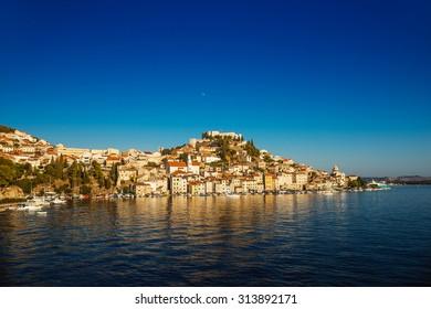 Sibenik is historic town in Croatia, located in central Dalmatia where river Krka flows into Adriatic Sea. Sibenik is political, educational, transport, industrial.