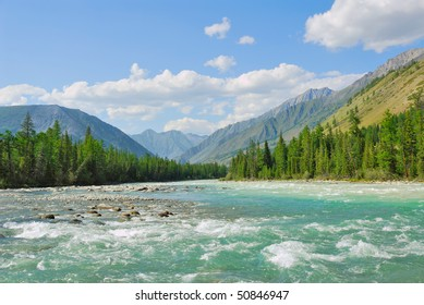 Siberia. Altai. View on green valley. Green mountains, blue sky, turquoise water of wild river