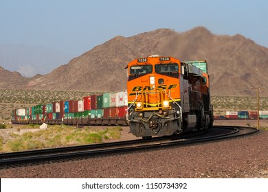 Siberia, California / United States - April 26, 2014: A BNSF Railway intermodal train twists through the Mojave desert.