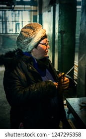 Siberia, Eastern Russia - 03.16.2015 / Female seller sells omul at a fish factory