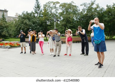 Siberia, Russia - July 30, 2016: group of Asian tourists taking pictures