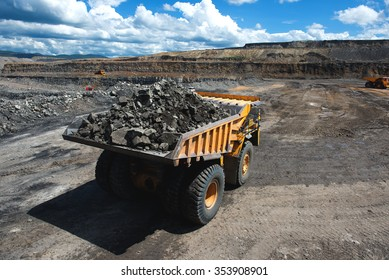 Siberia, Russia - June, 2015: Big yellow mining truck groundmoving in Russia.