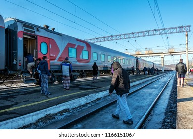 SIBERIA, RUSSIA - MARCH 20, 2018: Trans Siberian Express passengers get out of the station in 15 minutes and relax near Vladivostok, Russia.