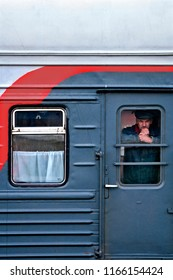 SIBERIA, RUSSIA - MARCH 20, 2018: Russian passenger is watching outside from Trans Siberian Express in Vladivostok, Russia.