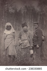 Siberia, Three escaped convicts standing in field, 'original title: 'Runaway Siberian convicts', photograph, 1885-1886.