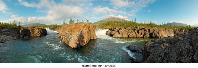 Siberia. Waterfall circus at Putorana plateau on the confluence of Dulismar and Yaktali rivers. Panorama.