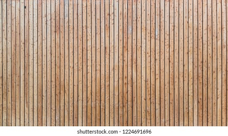 The Siberian larch facade made of wooden planks very clean wood on wall