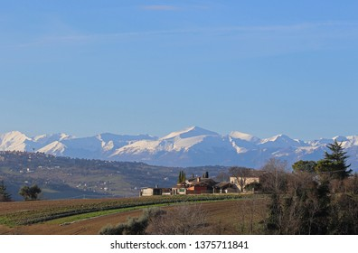 The Sibillini mountains part of the range of the Apennines seen from the countryside in Le Marche in Italy in spring monti sibillini or sibilline mountains by Ruth Swan