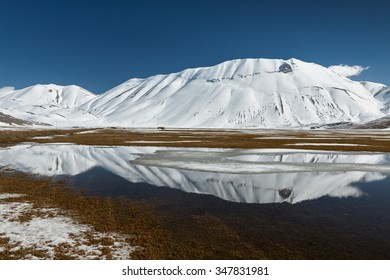 Sibillini mountains reflected in the water