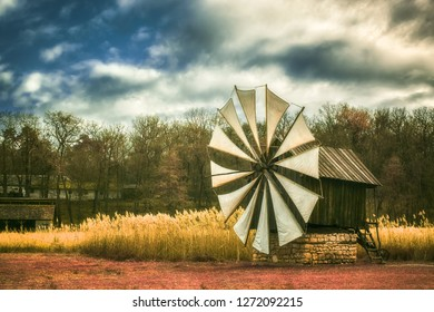 Sibiu city, Romania - November 17, 2018. Old authentic traditional wind mill in infrared, Astra Museum of Traditional Folk Civilization, Sibiu city, Romania