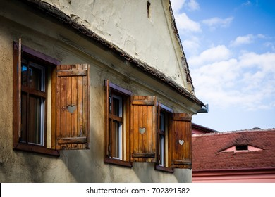 SIBIU - MAY 10: Vintage house with window shutters on May 10, 2016 in Sibiu, Romania. Sibiu is one of the most important cultural centres of Romania.
