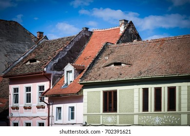 SIBIU - MAY 10: Vintage houses with eye-shaped dormers on May 10, 2016 in Sibiu, Romania. Sibiu is one of the most important cultural centres of Romania.
