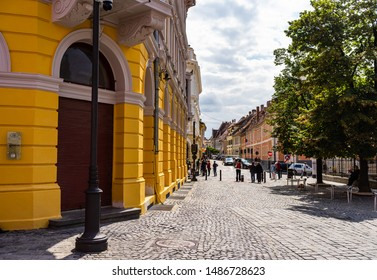 Sibiu, Romania - 2019. People wandering on the streets of Sibiu (old town). Streets with colorful houses.