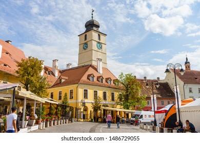 Sibiu, Romania - 2019. People wandering on the street of Sibiu near the Council Tower (Turnul Sfatului).