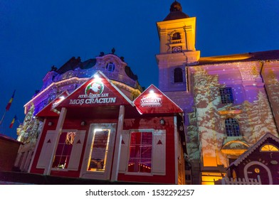 Sibiu, Romania - 21 December 2016: Christmas Market in Sibiu, Transylvania. Winter magic night image with tourists and Christmas decorations in Great Square of medieval town Sibiu