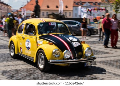 Sibiu, Romania - August 17, 2018. A Volkswagen Beetle rally car speeding up with motion blur effect during the Sibiu Rally 2018.