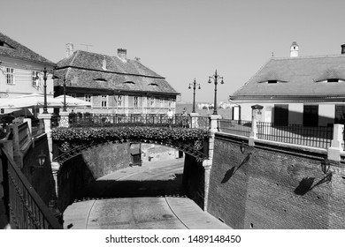 SIBIU, ROMANIA - AUGUST 24: People visit famous Bridge of Lies on August 24, 2012 in Sibiu, Romania. Sibiu's tourism is growing with 284,513 museum visitors in 2001 and 879,486 visitors in 2009.