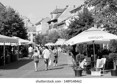 SIBIU, ROMANIA - AUGUST 24: People visit the Old Town restaurants on August 24, 2012 in Sibiu, Romania. Sibiu's tourism is growing with 284,513 museum visitors in 2001 and 879,486 visitors in 2009.