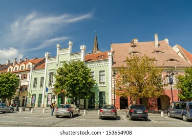 SIBIU, ROMANIA - AUGUST 26: The Small Square on August 26, 2013 in Sibiu, Romania. The buildings in the Small Square date since the 14th century and used to house crafts workshops and town guilds.