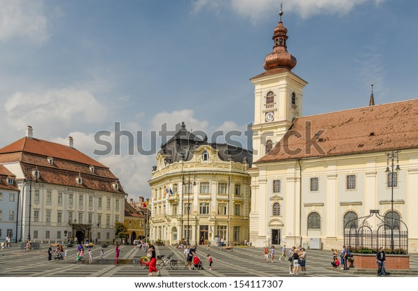 SIBIU, ROMANIA - AUGUST 27: The Main Square on August 27, 2013 in Sibiu, Romania. Sibiu is one of the most important cultural centers of Romania and was the European Capital of Culture in 2007.