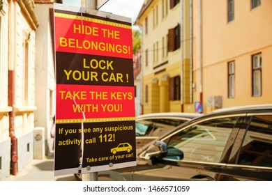 Sibiu, Romania - July 11, 2019: Warning sign for car drivers to protect their car and belongings against thieves. Copy-space on the right.