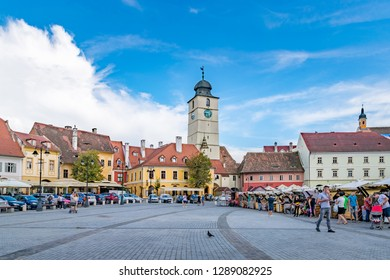 SIBIU, ROMANIA - July 21, 2018: Sibiu's council tower in the small swuare on a sunny summer day with a blue sky in Sibiu, Romania.
