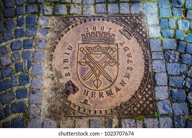 Sibiu, Romania - July 7, 2016: Close up on manhole cover on a pavement on the Old Town of Sibiu city