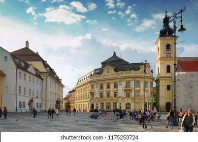 SIBIU, ROMANIA - JUNE 29, 2018: People walking on Large Square (Piata Mare), the historic centre of Sibiu, Transylvania, Romania