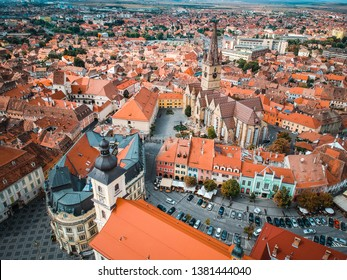 Sibiu, Romania - September 18 2018 - Aerial overview of the Evanghelical Lutheran Cathedral in  the Small Square (Piata Mica)
