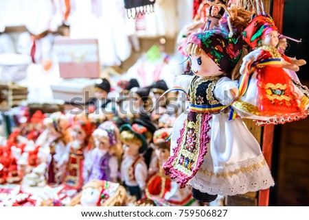 Sibiu, Romania - Winter dolls and decoration at Christmas Market, largest in Romania, Transylvania landmark.