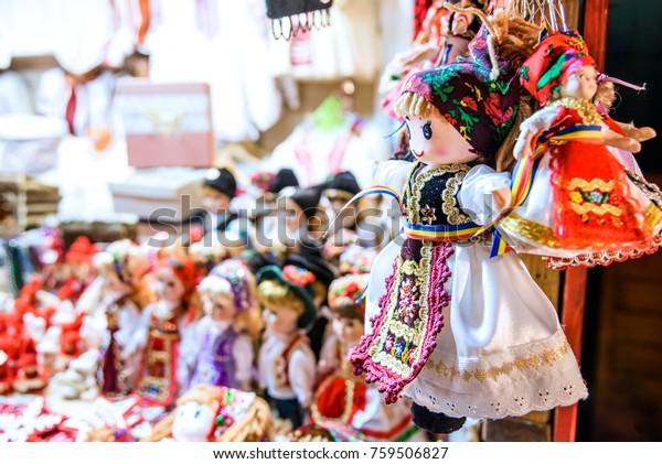 Sibiu, Romania - Winter dolls and decoration at Christmas Market, largest in Romania, Transylvania landmark.